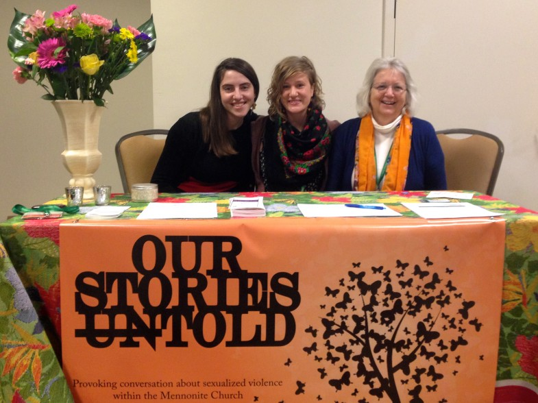 Left to right: Hilary Scarsella, Rachel Halder, and Barbra Graber at the Our Stories Untold booth at the All You Need Is Love conference.